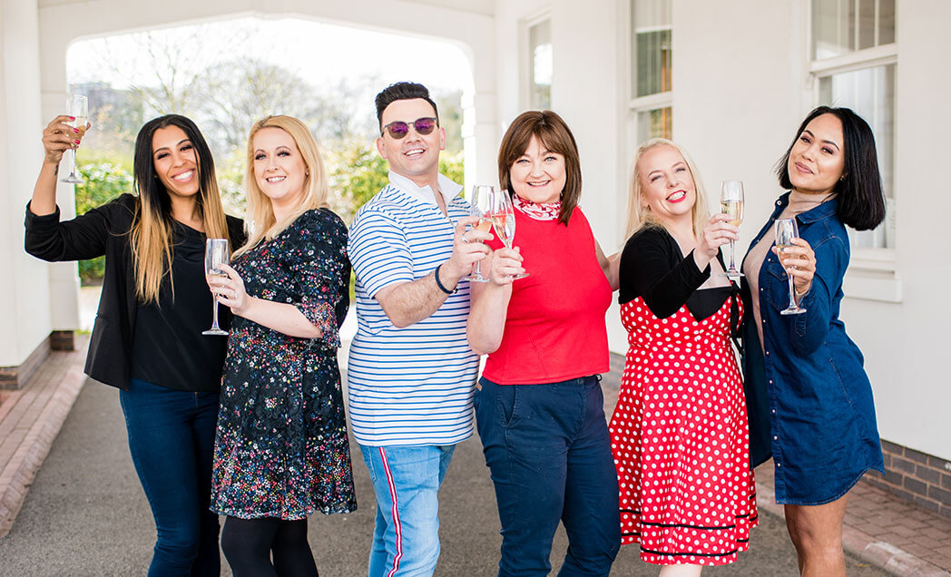 Image of Healthier Weight case studies celebrating their weight loss success with a toast