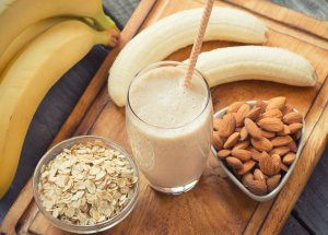 Image of ripe banana, nuts and fresh milkshake